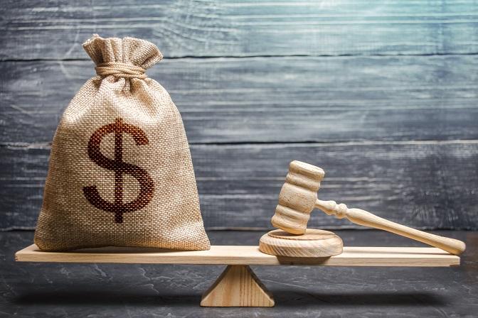 ¿Desde qué momento debe considerarse firme en vía administrativa una sanción tributaria a los efectos de aplicar en una infracción posterior el criterio de la reincidencia?